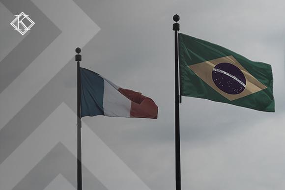 """Bandeiras do Brasil e da França ilustrando a publicação """"Acordo de previdência social entre França e Brasil, como funciona?"""""""