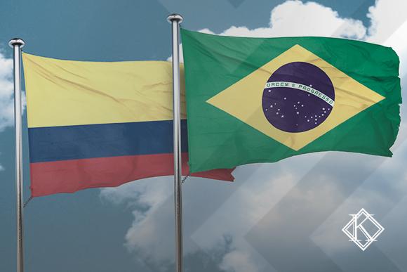 """Bandeiras do Brasil e da Colômbia. A imagem ilustra a publicação """"Acordo Colômbia e Brasil de Previdência Social"""", da Koetz Advocacia."""