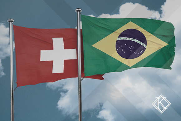 """A imagem mostra as bandeiras brasileira e sueca. Ilustra a publicação """"Acordo Previdenciário Suíça e Brasil: benefícios e como obtê-los?"""", da Koetz Advocacia."""